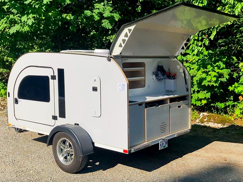 DROPLET XL teardrop camper comes with a bigger fridge and additional shelves.