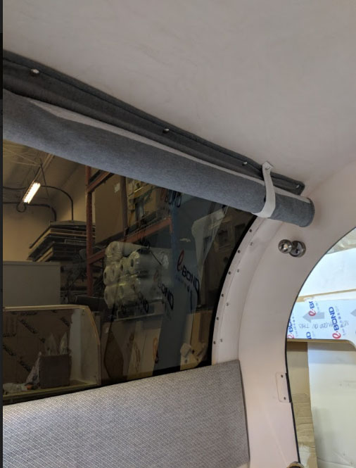 The window curtains offer privacy and extra insulation of the teardrop trailer