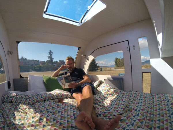 Spacious sleeping area in the micro camper by DROPLET Trailers