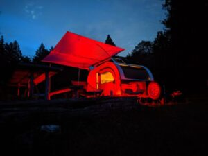 The awning by Shady Boy is an optional add-on for the DROPLET small camper