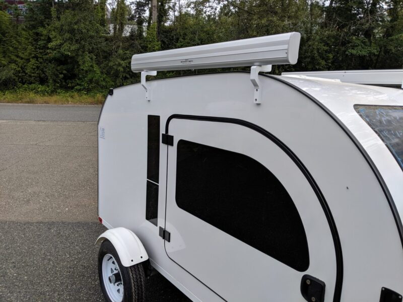 The awning by Shady Boy is an optional add-on for the DROPLET small trailer