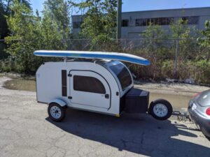 Transport your SUPs and kayaks with the Rhino-Rack for the DROPLET tiny camper